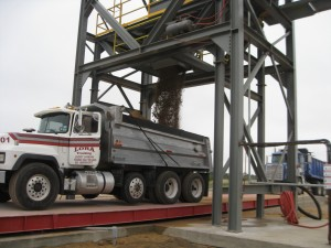 Cherry crews load a customer's truck with finished stabilized sand at our sixth and newest stabilized material plant in Fort Bend County.